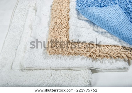 Stack of multicolored bath mats Stack of bath mats,folded on top of each other.  - stock photo