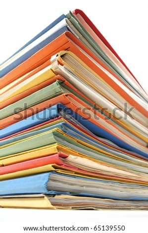 Stack of multicolored folders with documents on white background