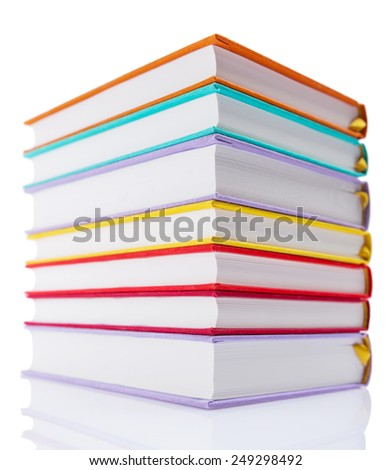 stack of new books in colorful hard cover isolated on white background - stock photo