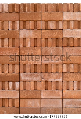 Stack of new red bricks  isolated on white background