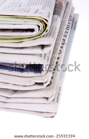 Stack of newspapers isolated on white