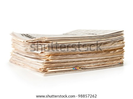 Stack of newspapers on white background.