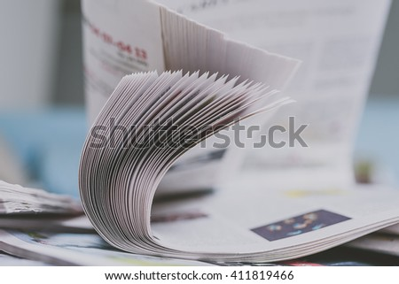 Stack of newspapers, selective focus