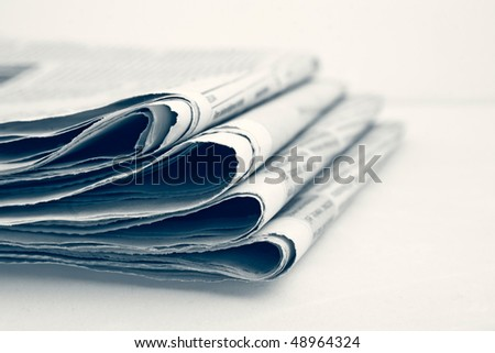 Stack of newspapers. shallow dof - stock photo