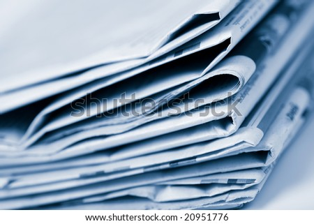 stack of newspapers toned blue - stock photo