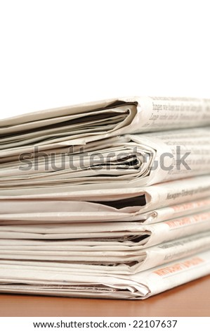 Stack of newspapers with selective focus