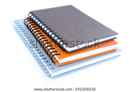 Stack of notebooks (or copybooks) on white background