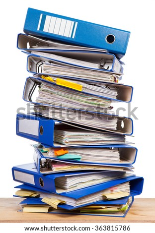 Stack of office folders on a table over white background