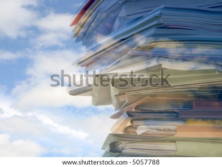 Stack of office folders, reports and paperwork overlaid with cloud pattern - stock photo