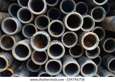 Stack of oilfield casing on the drilling rig - stock photo
