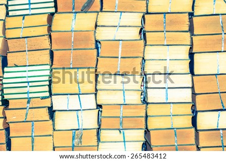 Stack of old books, abstract pattern for vintage background