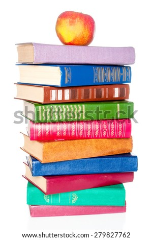 Stack of old books and an apple on white background - stock photo