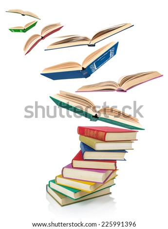 stack of Old books and flying books isolated on white - stock photo