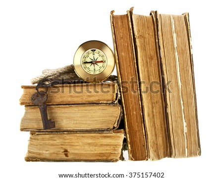 Stack of old books, compass, old keys and rope on a white background - stock photo