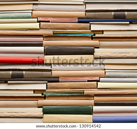 Stack of old books. No labels, blank spine. - stock photo