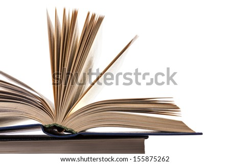 stack of old books on a white background, an open book on a pile of books