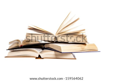 stack of old books on a white background, an open book on a pile of books - stock photo