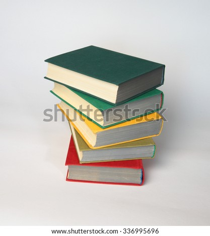 Stack of old books on white as a symbol of education and knowledge - stock photo