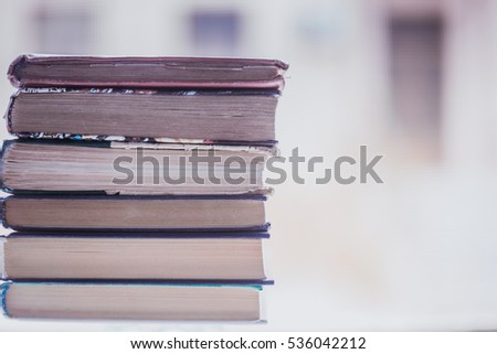stack of Old books on wooden desk