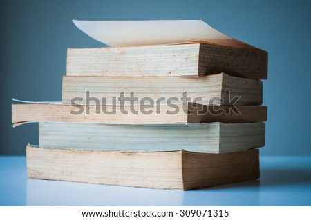Stack of old books perspective.