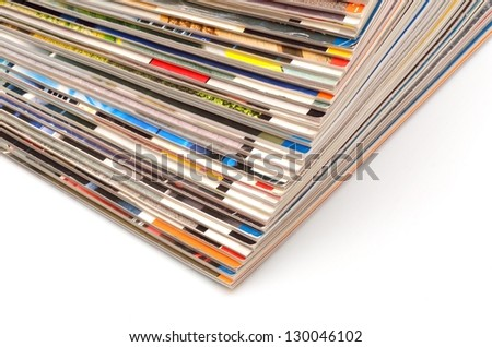 Stack of old colored magazines on white background - stock photo