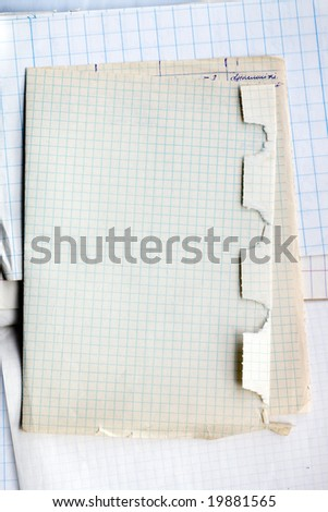 Stack of old cross lined papers from note book. - stock photo