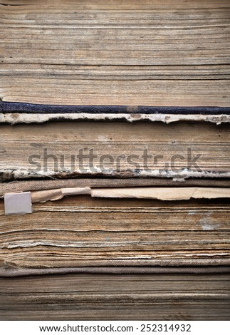Stack of old dirty tattered books - stock photo