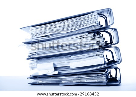 Stack of old documents in binders against white background. Office life. Blue tone. - stock photo