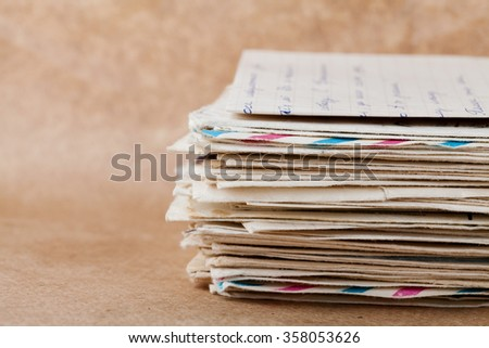 Stack of old envelopes and letters on kraft paper - stock photo