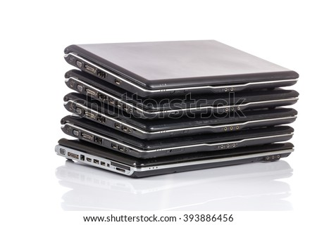 stack of old laptops awaiting repair isolated on white background - stock photo