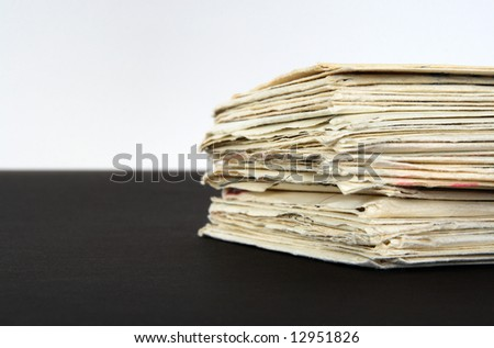 Stack of old letters on black and white background.
