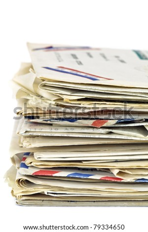 Stack of old letters, over white background.  Air mail, postcards and typed letters.