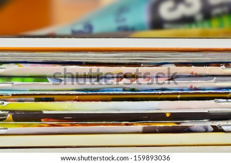 Stack of old magazines - stock photo