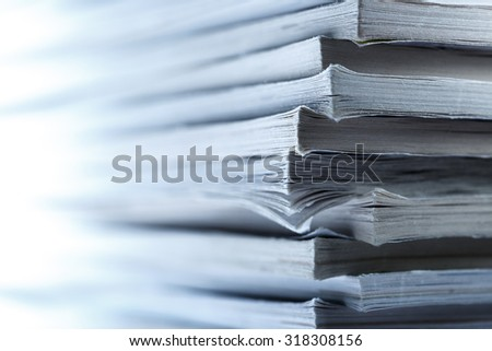 Stack of old magazines as background  in toning