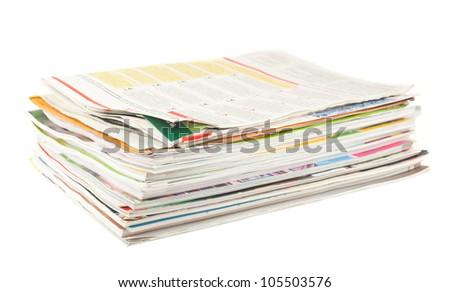 Stack of old magazines isolated on white background - stock photo