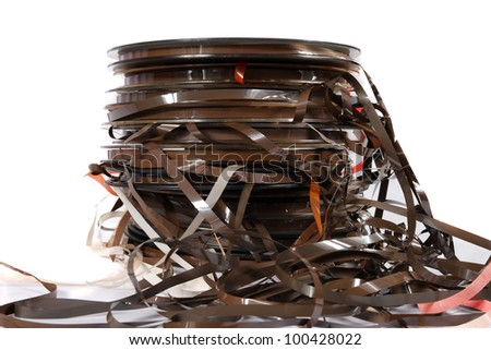 stack of old magnetic tapes on white - stock photo