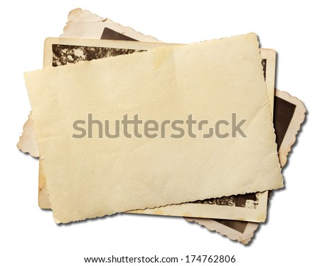 Stack of old photos isolated on white with clipping path included - stock photo