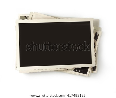 stack of old photos on white - stock photo