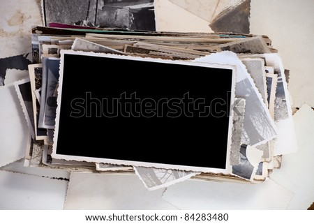 Stack of old photos with one blank photo for your image. - stock photo
