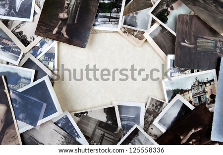 Stack of old photos with space for your logo or text. - stock photo
