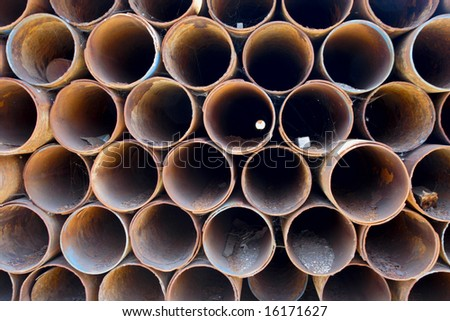 stack of old rusty pipes close-up