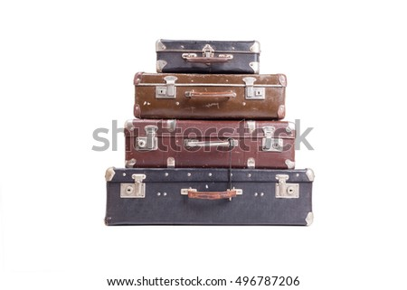 Stack of old vintage suitcases isolated on white