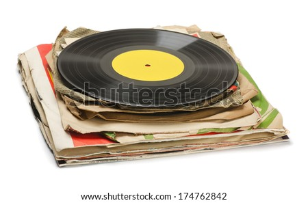 Stack of old vinyl records isolated on white - stock photo