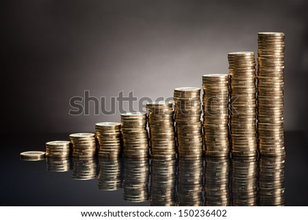Stack Of One Euro Coins Over Black Background - stock photo