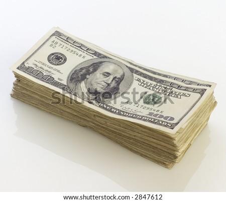 Stack of one hundred dollar bills. - stock photo