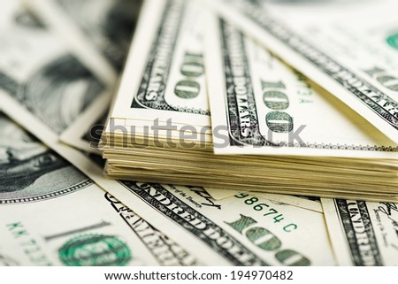 Stack of one hundred dollar bills close-up. (shallow DOF)  - stock photo