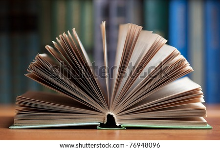Stack of open books at the library - stock photo