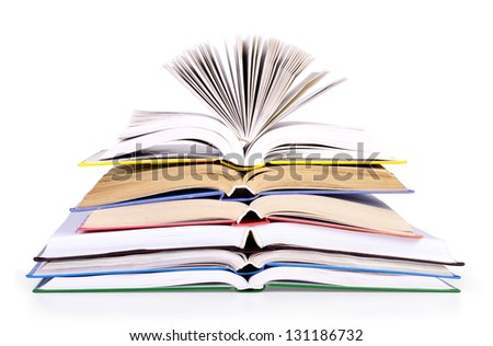Stack of open books on a white background. - stock photo