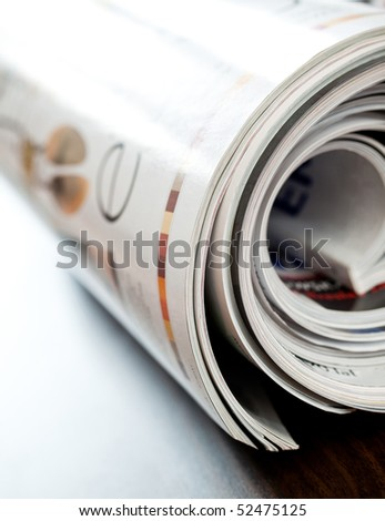 Stack of open colorful magazines - close-up - stock photo