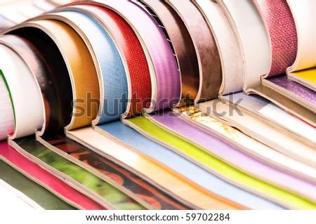 Stack of open magazines - stock photo